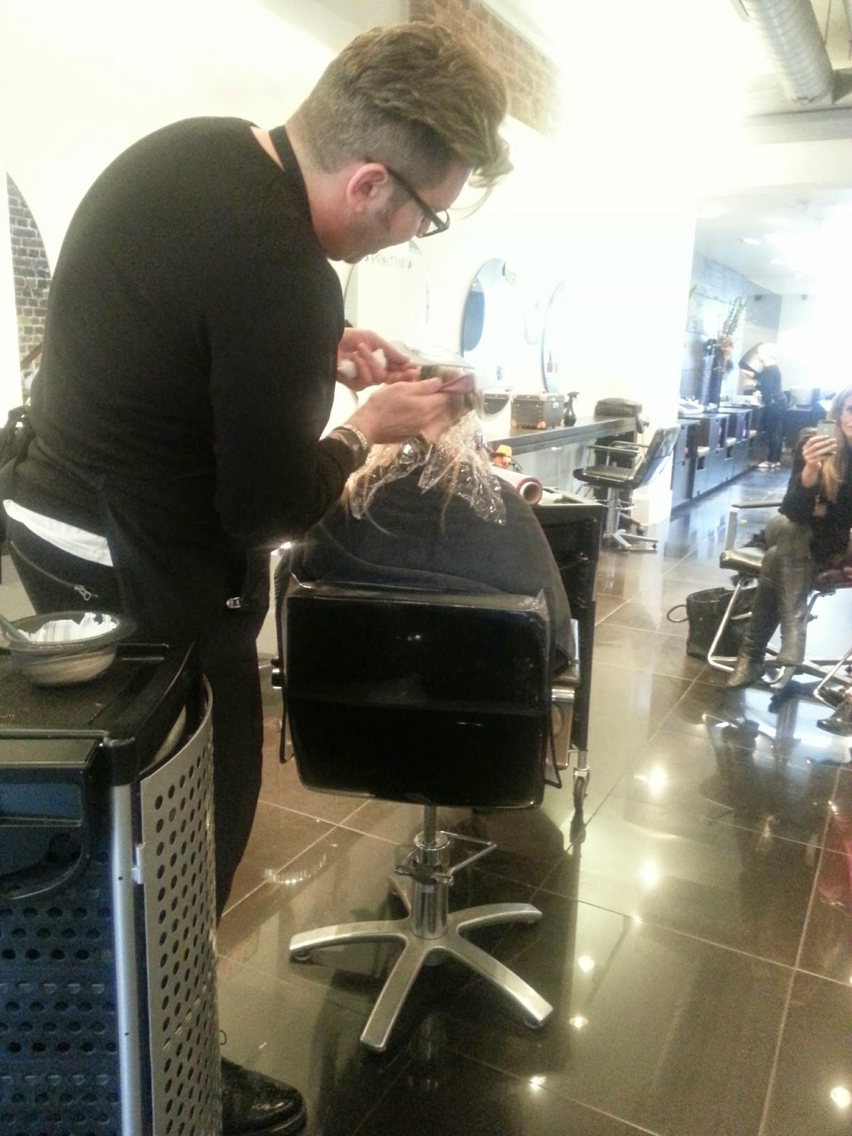 Jack Howard working on his model at his balayage class