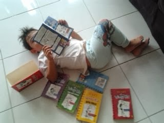 Ashraf reading Wimpy Kid