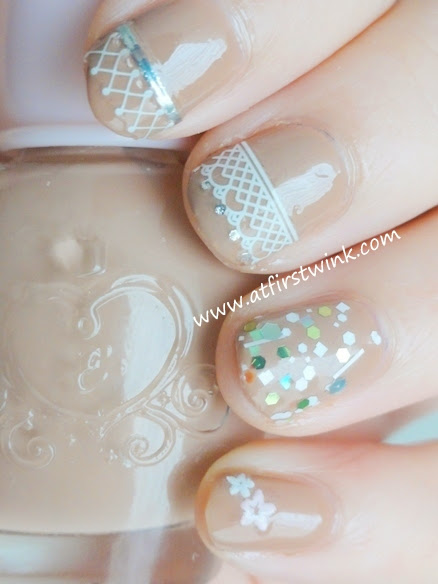 Etude House beige nail polish with lace nail stickers and Innisfree glitter nail polish on the ring finger