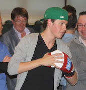 John Joe's boxing gloves (modelled by Niall) sold over more than €350! (img )