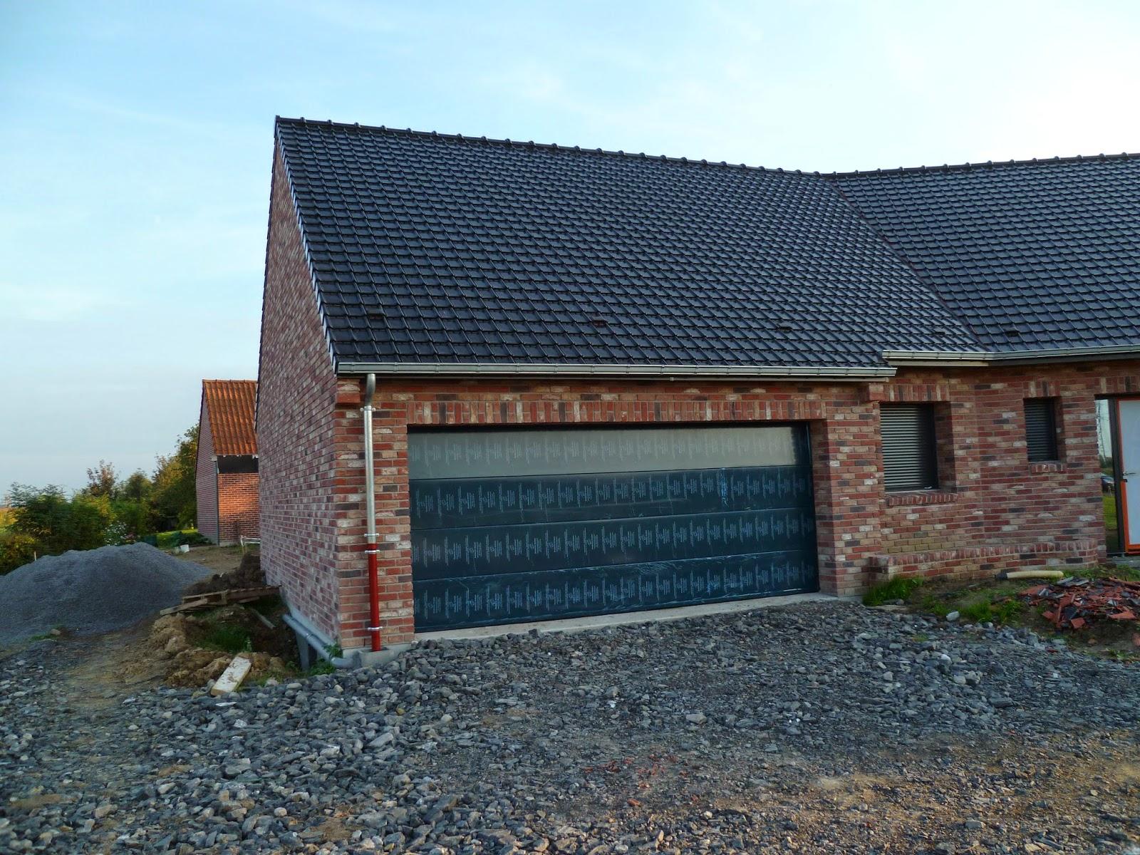 Notre maison estaires pose de la porte de garage - Porte de garage 5m ...