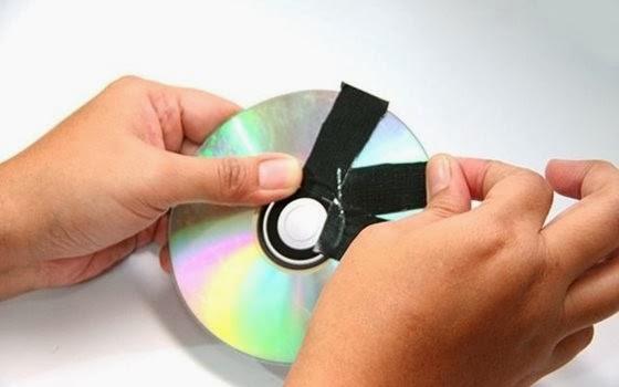 Umas das formas destruir um DVD ou CD é com fita adesiva - 560x350
