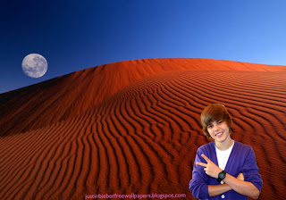 Wallpaper of Justin Bieber Salutes the fans at Red Moon Desert desktop wallpaper
