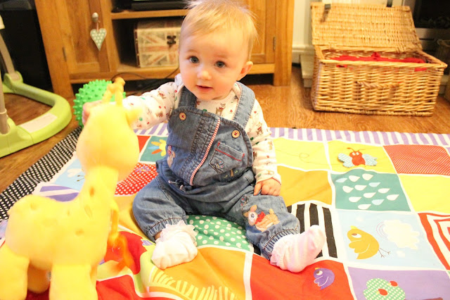 baby girl wearing vintage style denim dungarees from next