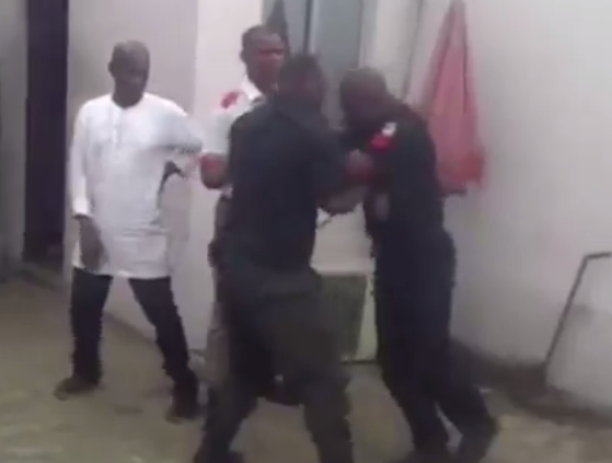 Photos: Two policemen fight in public  8