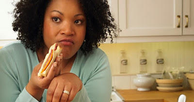 Woman eating processed food and bread