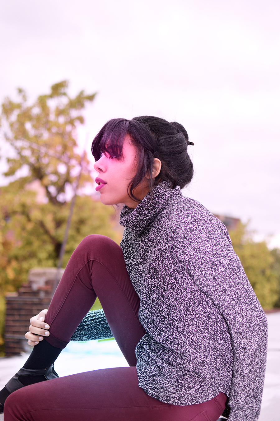 brooklyn fashion blogger anais alexandre on her rooftop enjoying sweater weather