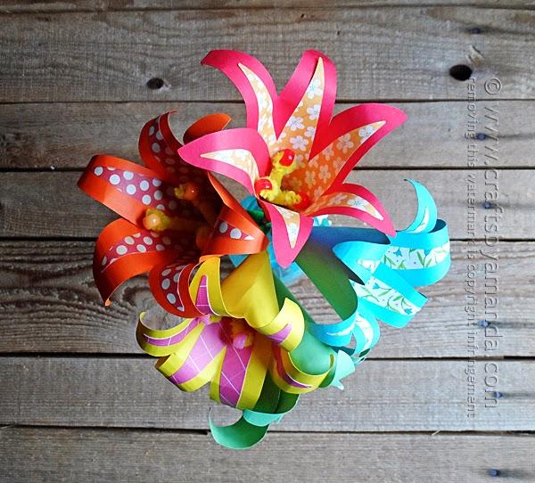 http://craftsbyamanda.com/2014/06/tropical-paper-flowers.html