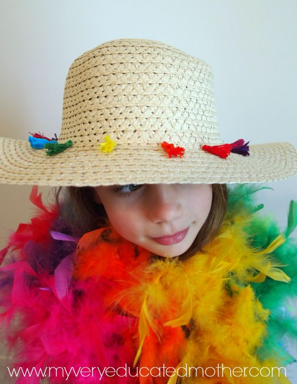 A rainbow feather boa is the best accessory to go with a DIY Tassel Hat!