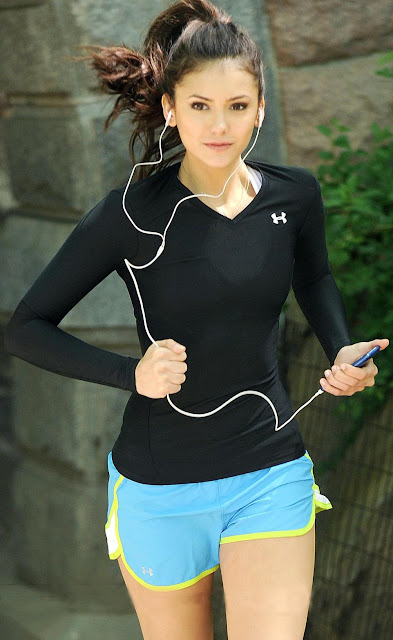 Nina Dobrev in Running Shorts
