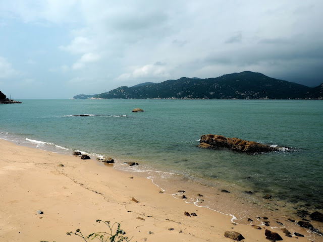 View of Lantau Island from a beach on the north side of Cheung Chau Island, Hong Kong