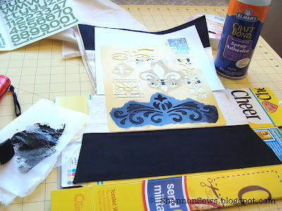 Use adhesive bond to adhere pre-made stencils to fabric