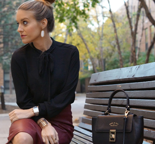black tie blouse styled with leather skirt