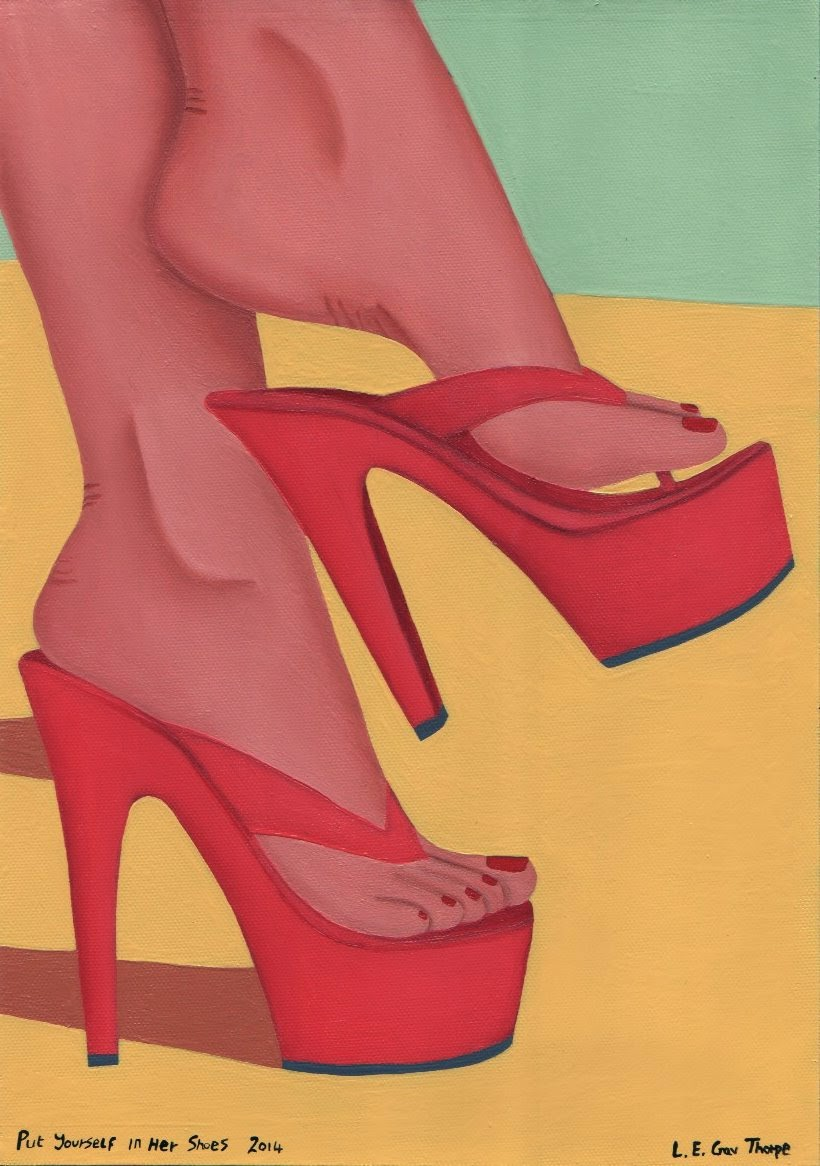 A woman dangling a red sandal from her foot