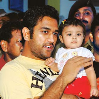 dhoni with baby