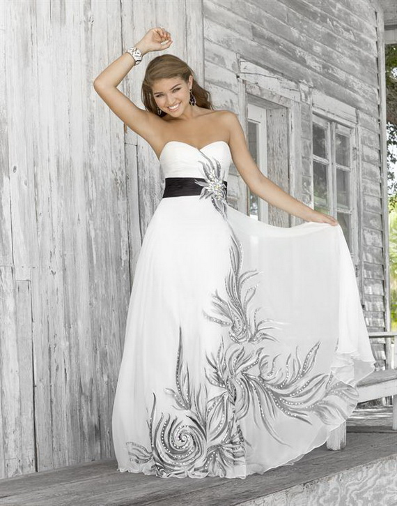 white strapless sweetheart prom dress with black sash and beaded accents