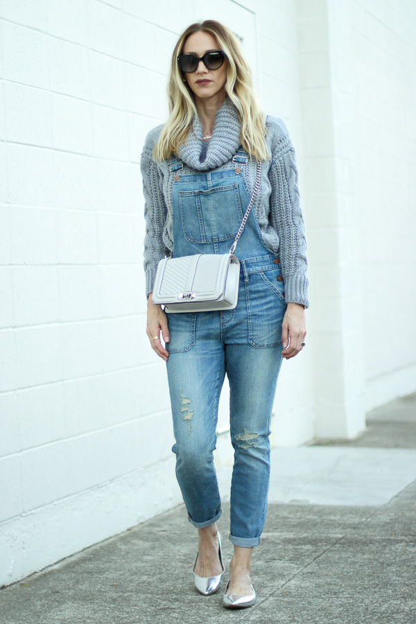 fitted denim coveralls with chunky knit sweater