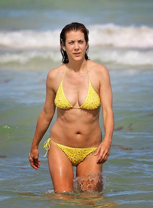 The 46-year-old shows off about how the age can be finishing their beach style into a perfect point as she enjoys a vacation with boyfriend, Chris Case in Miami, FL, USA.