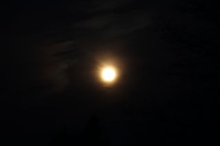 photo of moon with ring around it