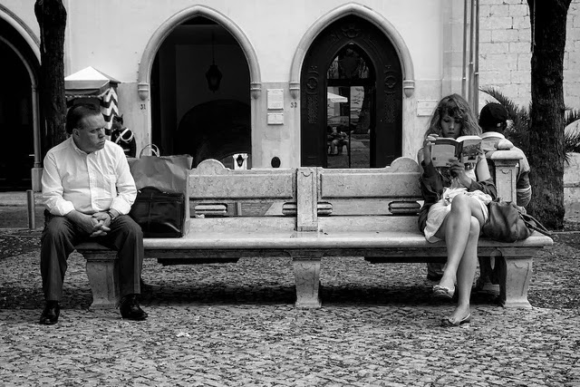 Man staring at woman across bench