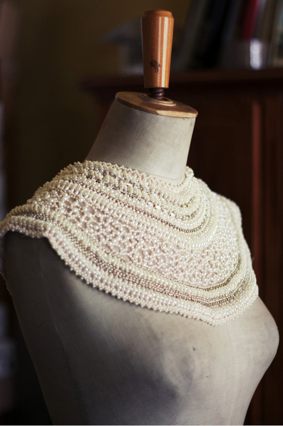 Intricate handmade collar with imitation pearls