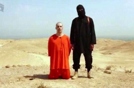 """Jihadi John"" with one of his beheading victims."
