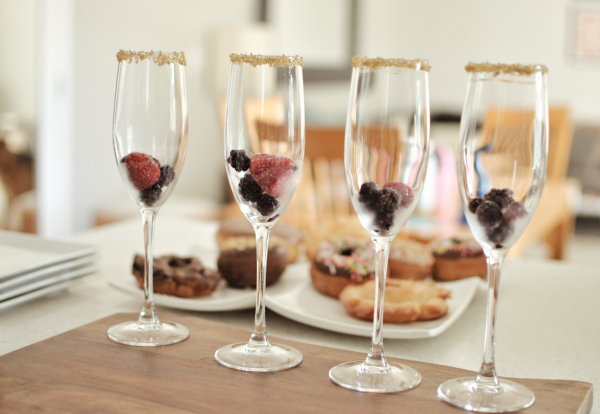 champagne flutes with gold glitter