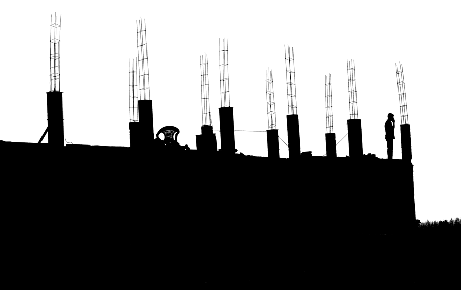 silhouette of building under construction