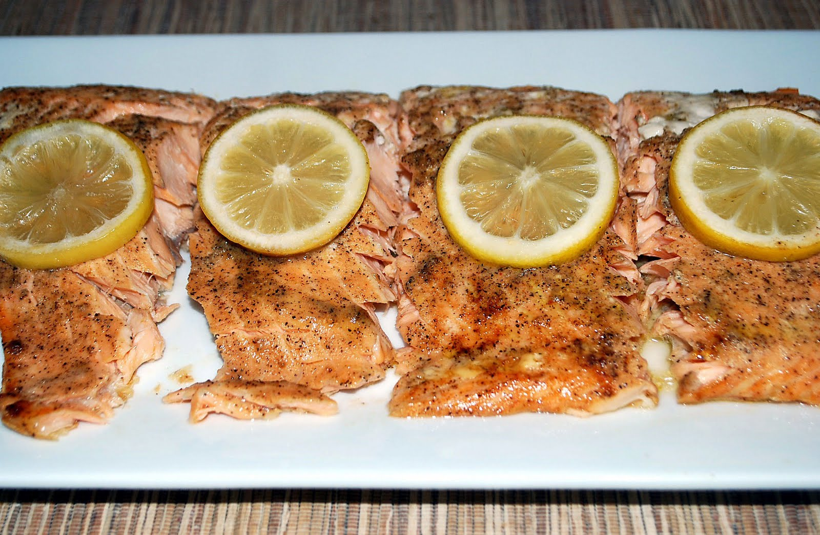 We Eat A Lot Of Salmon In This House And I Love To Bake It With Fresh  Lemons And Lemonpepper This Is A Great Quick And Easy Recipe That Is  Delish