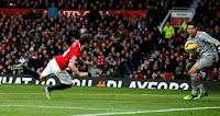 Manchester United's Juan Mata (L) heads the ball  to score the second goal past Liverpool's goalkeeper Brad Jon …
