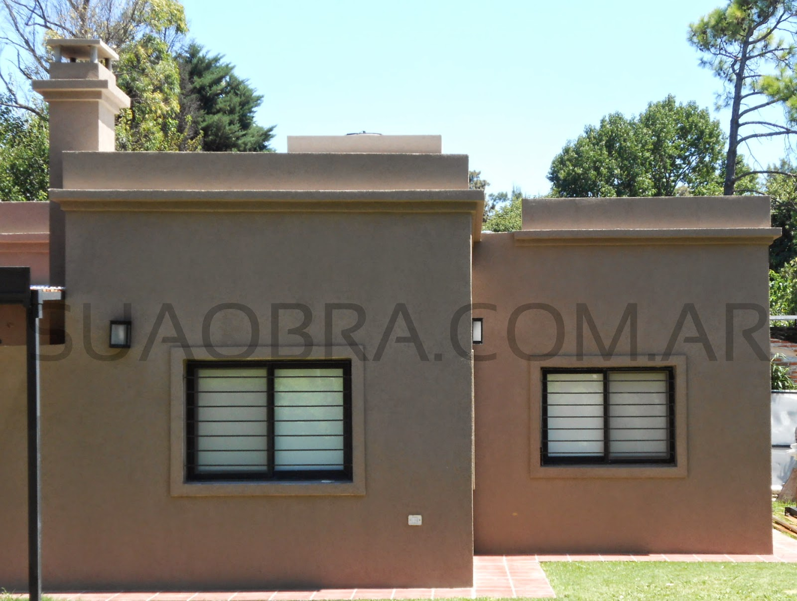 Tarquini aplicacion revestimientos plasticos exteriores for Pintura para pared exterior