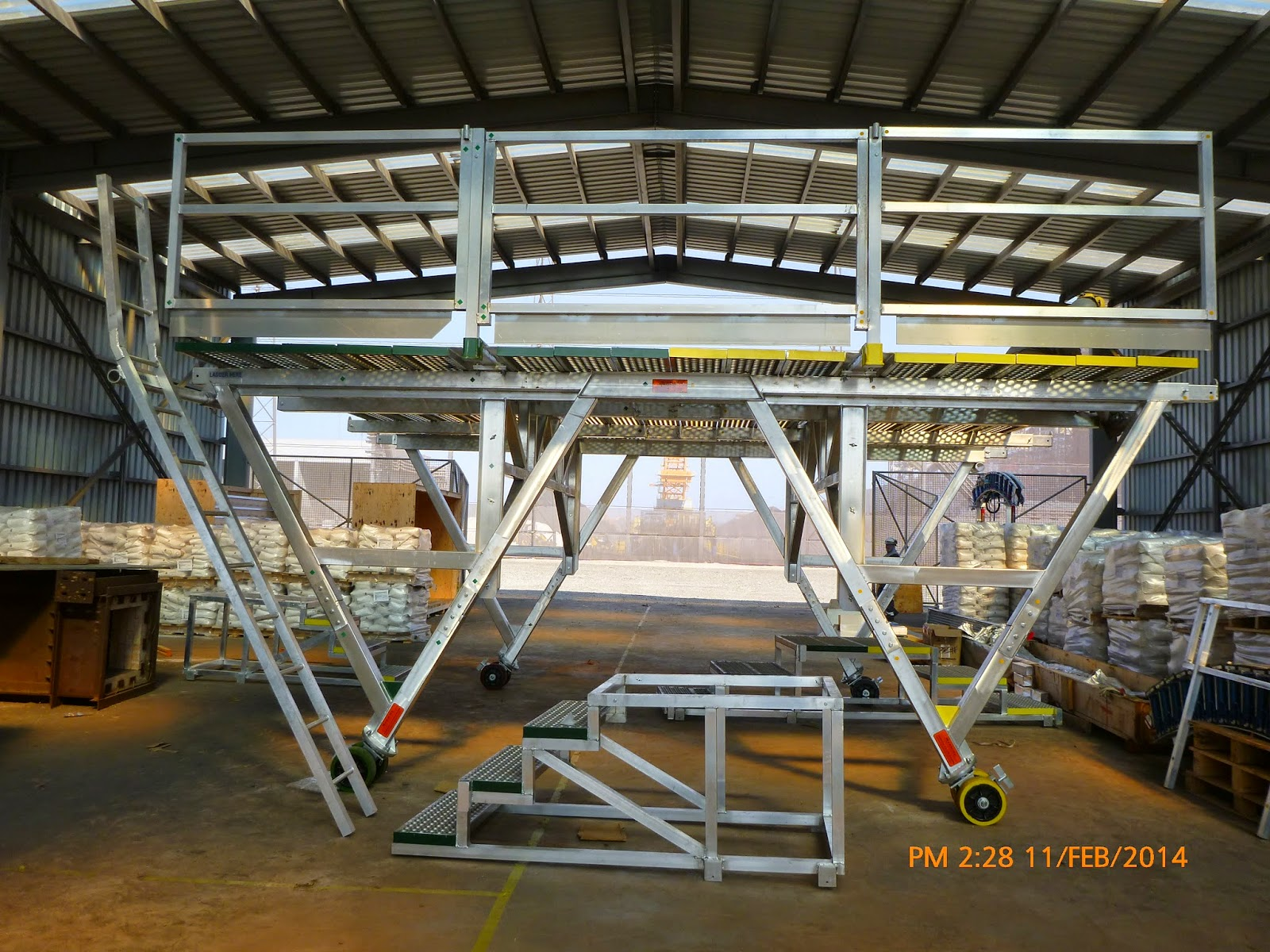 Bricking machine platform completely assembled with the safety hand rail and ladder.
