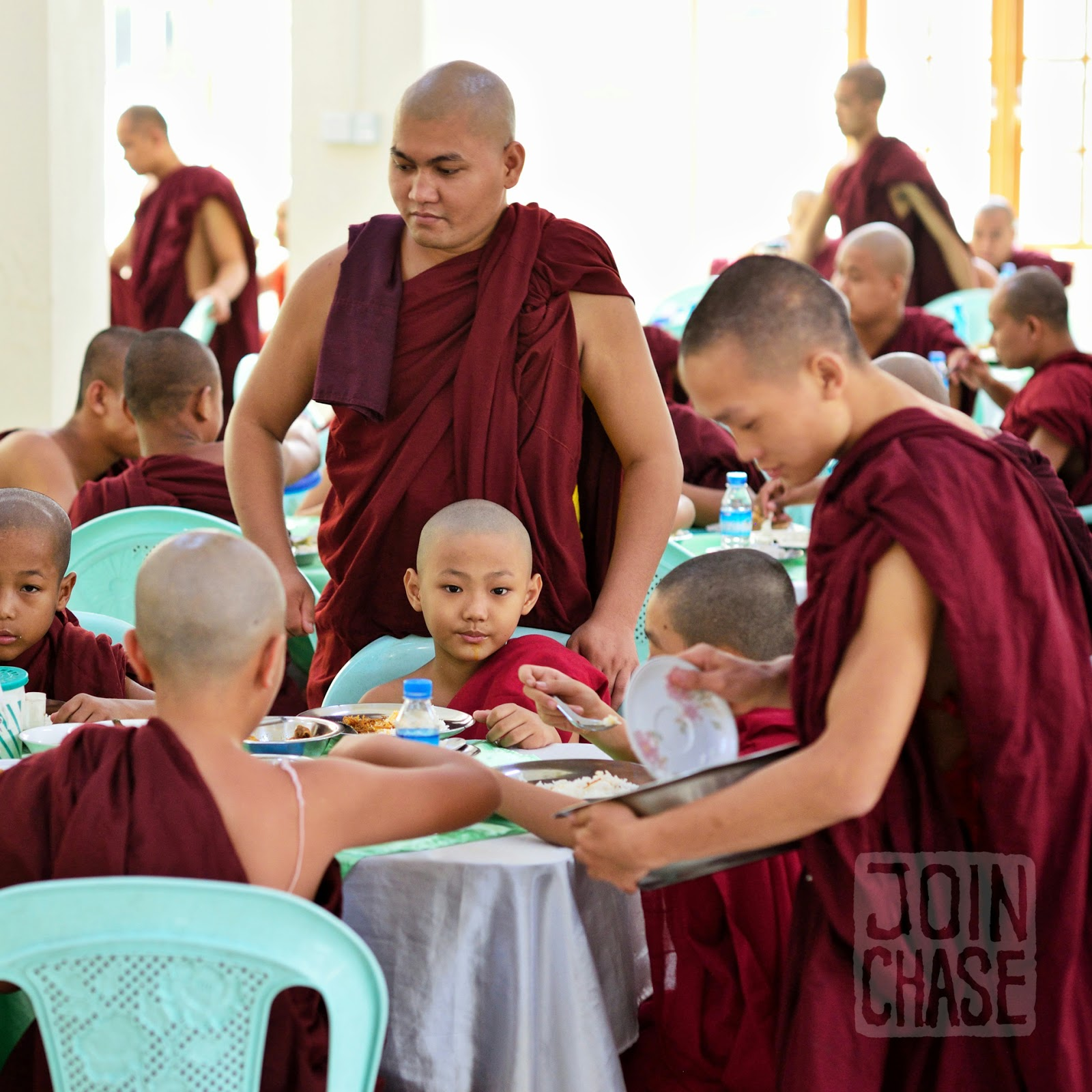 Novice monks eating lunch together during Thingyan in Yangon, Myanmar.