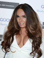 Tamara Ecclestone showing off her assest in a white dress