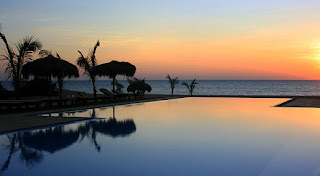 Sun setting over Palagama Beach Resort Infinity pool