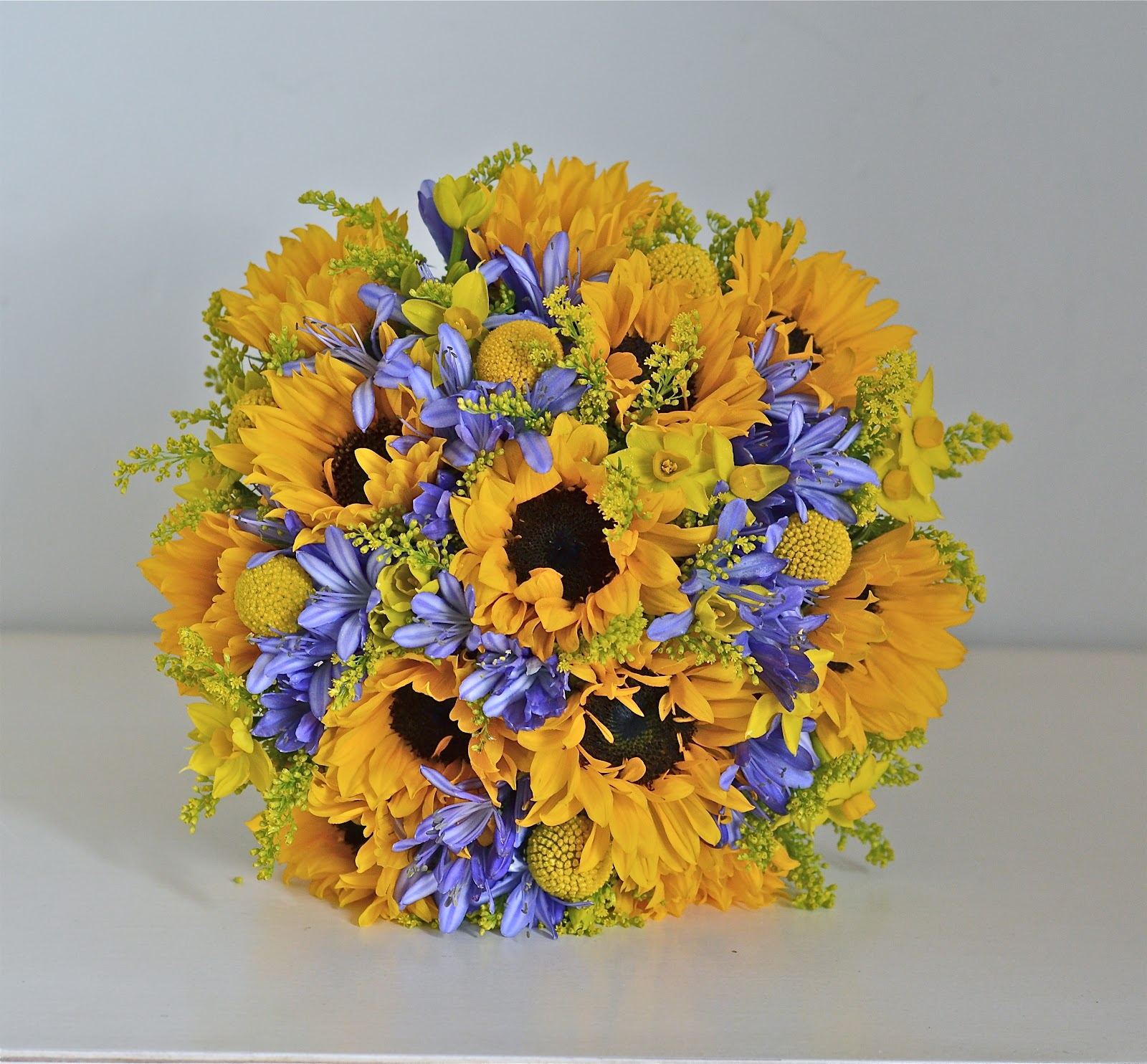 Wedding flowers blog emmas yellow and blue wedding flowers bouquet of sunflowers blue agapanthus mini narcissus craspedia and solidago for emma i used the mini sunflower here they are gorgeous but just one mightylinksfo