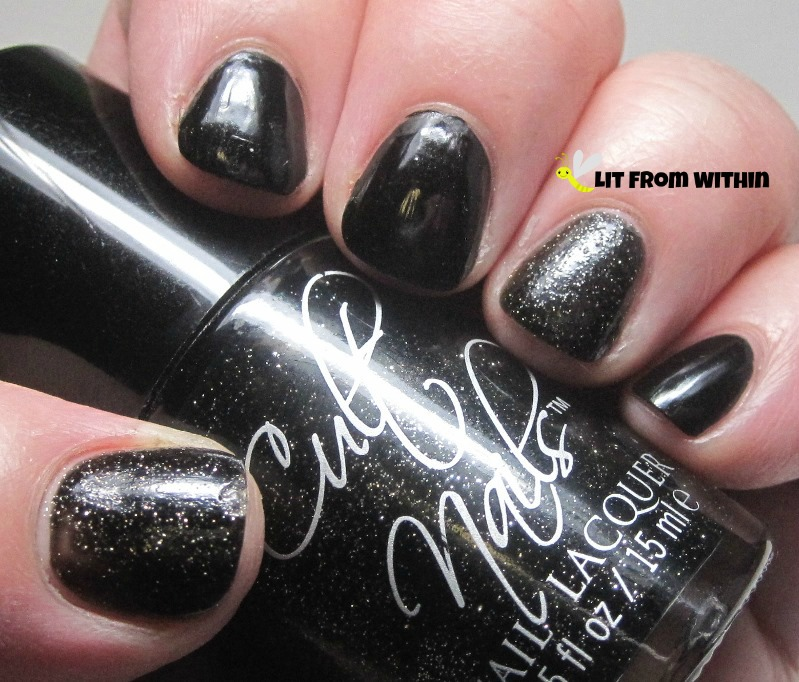 Wet 'n Wild Black Creme and accents of Cult Nails Ignite