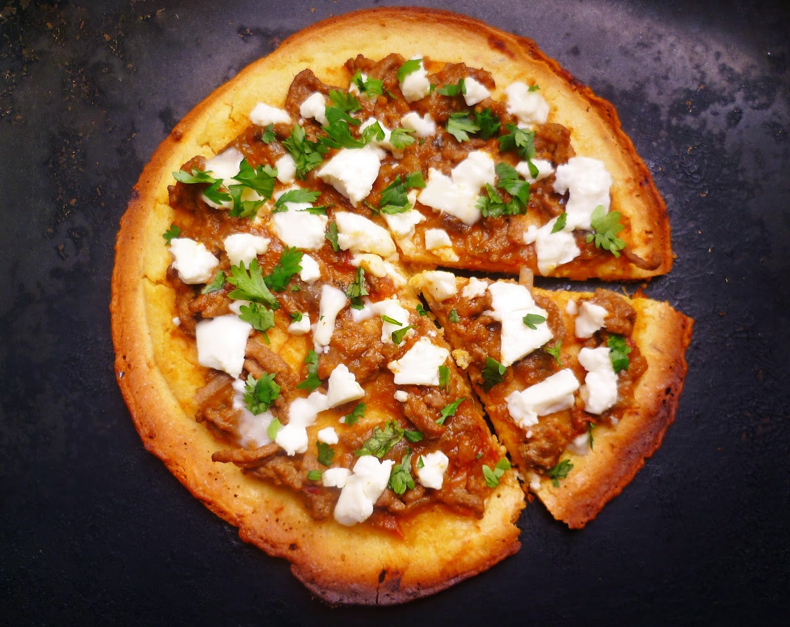 socca pizza with lamb aubergine and feta pizza is one of the dishes ...