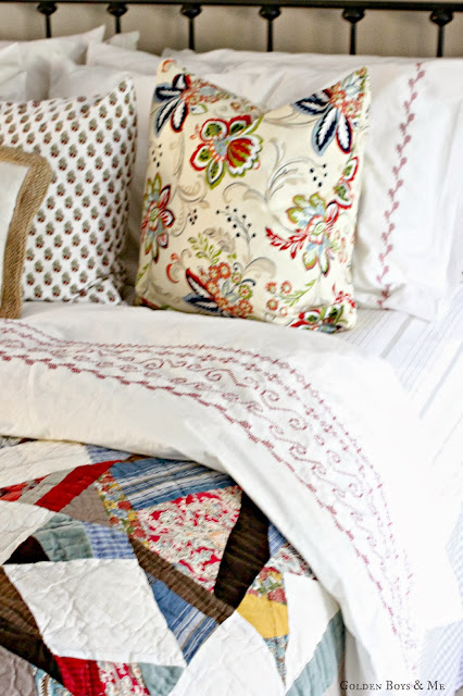 Pottery Barn Multistar Patchwork Quilt with Ikea duvet in Master Bedroom via www.goldenboysandme.com