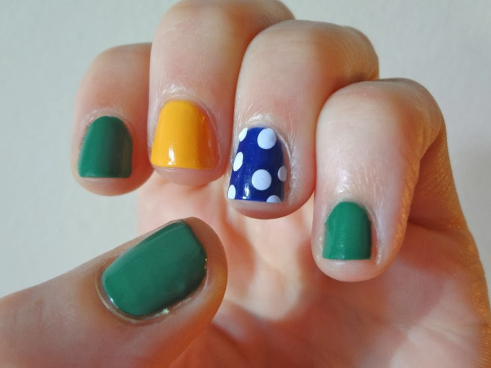 Jewel toned nails, polka dot accent nail
