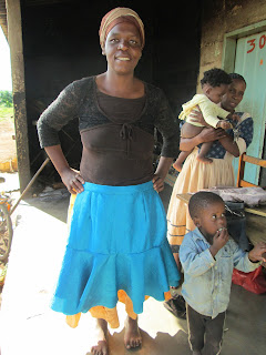 Ncamsile showing off a skirt from the sewing class