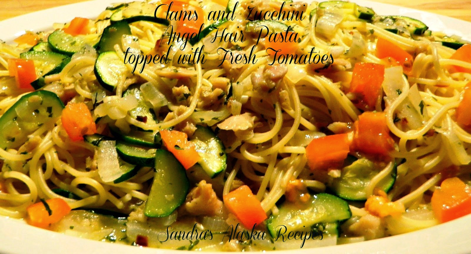 ... CLAMS and ZUCCHINI ANGEL HAIR PASTA topped with FRESH TOMATOES