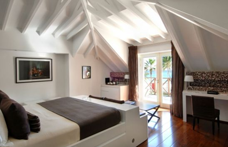 white bedroom suite in villa rockstar in hotel eden rock in st. barths caribbean islands