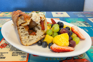 Sausage and Peppers Sandwich with Fresh Fruit, Angle 1