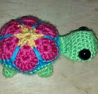 http://www.ravelry.com/patterns/library/small-flower-turtle