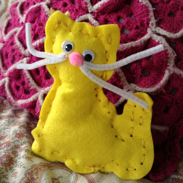 yellow stuffed cat pipe cleaner whiskers