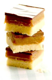 Stack of millionaires shortbread squares topped with caramel toffee and chocolate