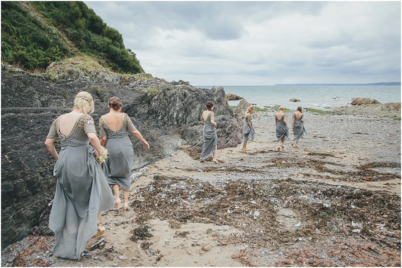 Bridesmaids in grey dresses on the beach