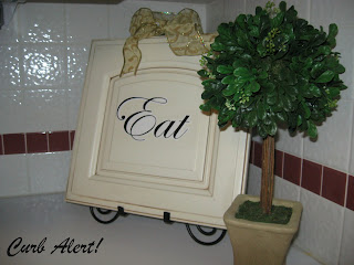 cabinet door with eat written on it