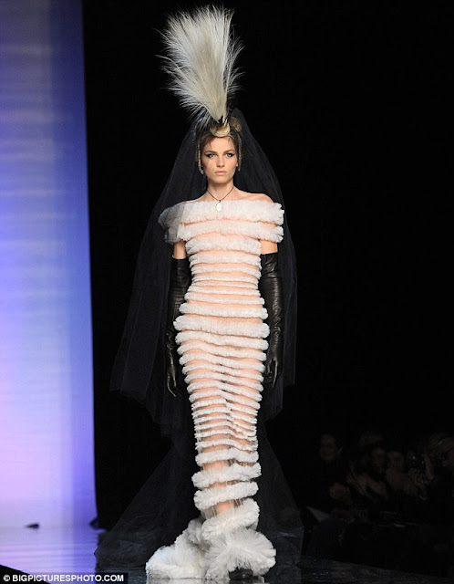 Male model Andrej Petric modelling a bridal dress for Jean Paul Gaultier